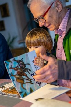 kevin-the-kangaroo-grandfather-reads-book-to-henio